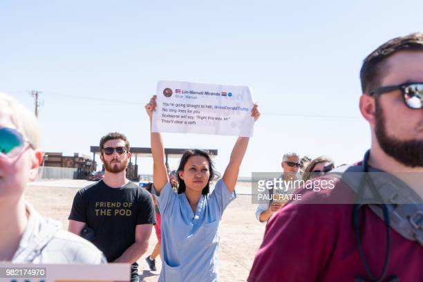 Melissa Wong an OBGYN from El Paso Texas holds up a poster at the Tornillo Port of Entry in Tornillo Texas along with medical professionals to demand...