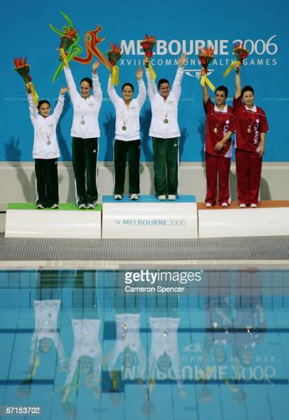Melissa Wu and Alexandra Croak of Australia Loudy Tourky and Chantelle Newbery of Australia and Roseline Filion and Meaghan Benefito of Canada pose...