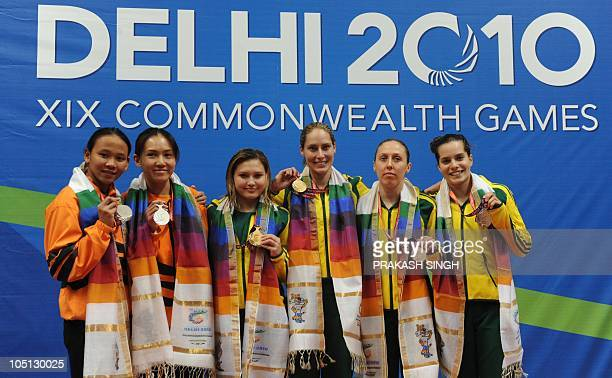 Melissa Wu and Alexandra Croak of Australia Pandelela Rinong Pamg and Mun Yee Leong of Malaysia and Briony Cole and Anabelle Smith of Australia pose...