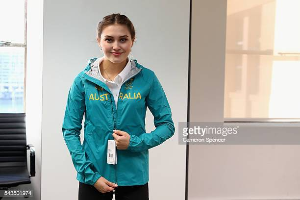 Melissa Wu models her new Olympic jacket during the Australian Olympic Games diving team announcement at the Museum of Contemporary Art on June 29...