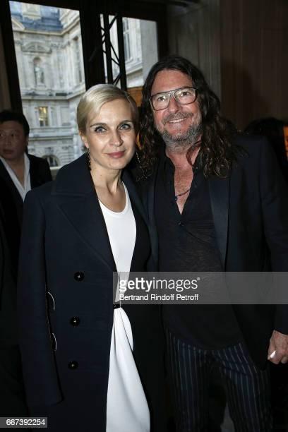 Melita Toscan du Plantier and JacquesAntoine Granjon attend the LVxKOONS exhibition at Musee du Louvre on April 11 2017 in Paris France