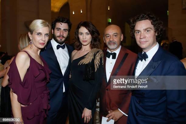 Melita Toscan du Plantier Ben Cura his companion Olga Kurylenko Stylist Christian Louboutin and EIC Esquire Jay Fielden attend the Liaisons au Louvre...