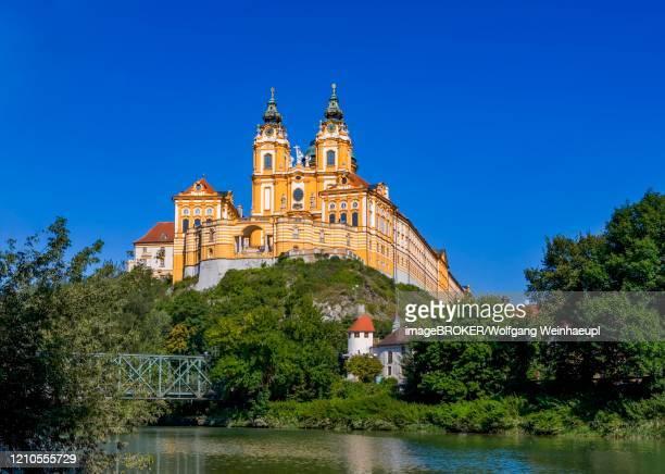 melk abbey and river danube, wachau, lower austria, austria - abbazia foto e immagini stock