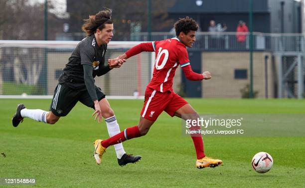 Melkamu Frauendorf of Liverpool and Alvaro Fernandez of Manchester United in action during the U18 Premier League game between Liverpool and...