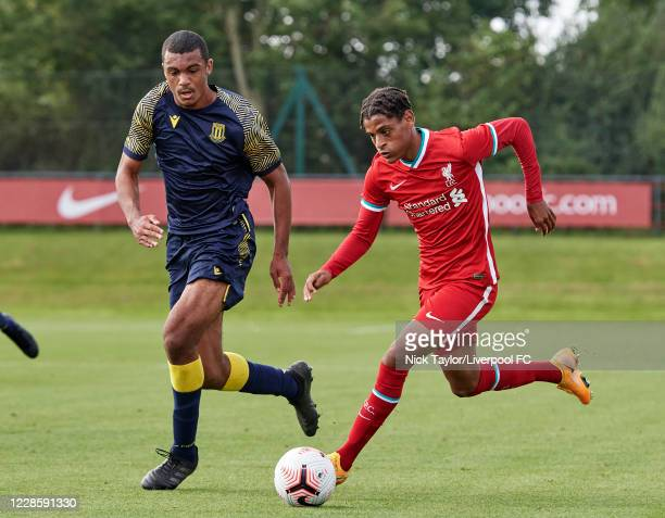 Melkamu Frauendorf of Liverpool and David Okagbue of Stoke City in action during the U18 Premier League game at The Kirkby Academy on September 19...