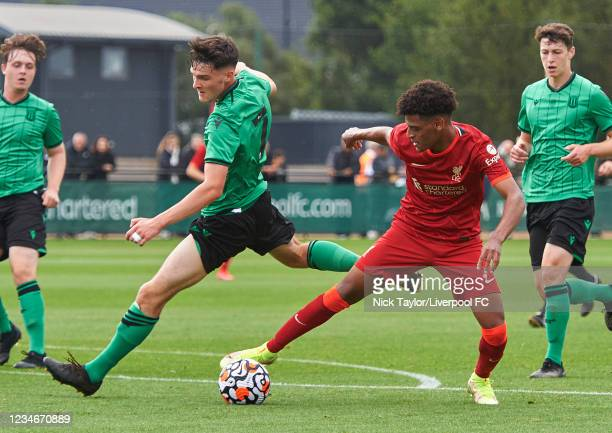 Melkamu Frauendorf of Liverpool and Sam Knowles of Stoke City in action during the U18 Premier League game at AXA Training Centre on August 14, 2021...