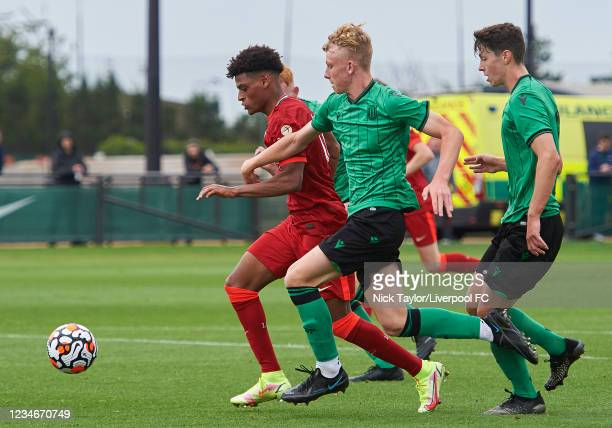 Melkamu Frauendorf of Liverpool and Tom Curl of Stoke City in action during the U18 Premier League game at AXA Training Centre on August 14, 2021 in...