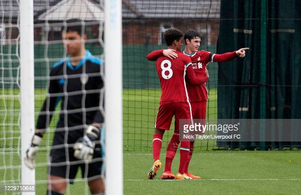 Melkamu Frauendorf of Liverpool celebrates scoring Liverpool's third gaol with assist Layton Stewart at Melwood Training Ground on November 21, 2020...