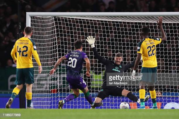 Melker Hallberg of Hibernian FC scores his team's first goal past Fraser Forster of Celtic FC during the Betfred Cup Semi-Final match between...