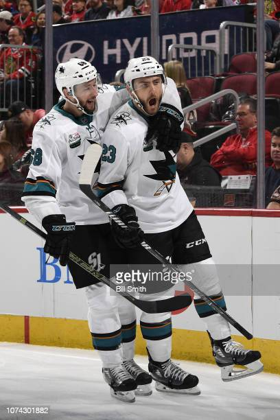 Melker Karlsson and Barclay Goodrow of the San Jose Sharks react after Goodrow scored against the Chicago Blackhawks in the second period at the...