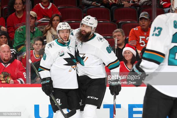 Melker Karlsson and Brent Burns of the San Jose Sharks celebrate after Karlsson scored against the Chicago Blackhawks in the first period at the...
