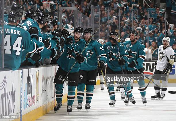Melker Karlsson Chris Tierney Chris Tierney and Brenden Dillon of the San Jose Sharks celebrate Karlsson's goal with teammates on the bench as Sidney...