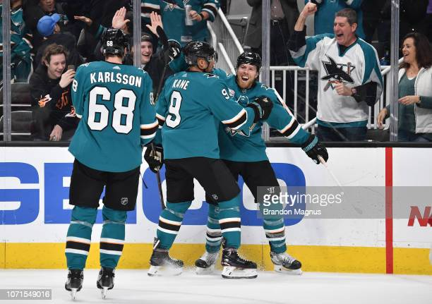 Melker Karlsson Evander Kane and Joe Pavelski of the San Jose Sharks celebrate scoring a goal against the New Jersey Devils at SAP Center on December...