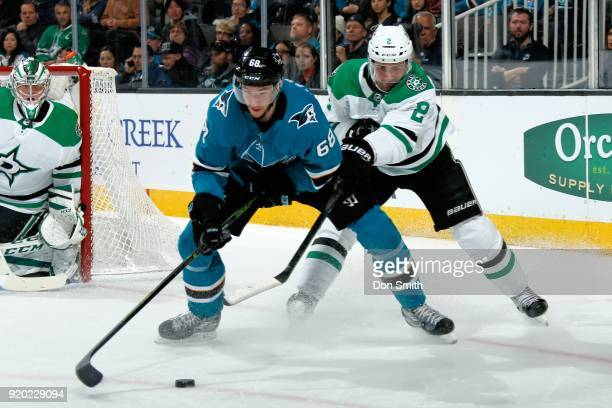 Melker Karlsson of the San Jose Sharks and Dan Hamhuis of the Dallas Stars battle for the puck at SAP Center on February 18 2018 in San Jose...