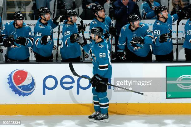 Melker Karlsson of the San Jose Sharks celebrates his first period goal against the Dallas Stars with teammates at SAP Center on February 18 2018 in...