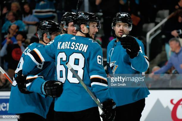Melker Karlsson of the San Jose Sharks celebrates the goal of Justin Braun in the second period against the Dallas Stars with teammates at SAP Center...