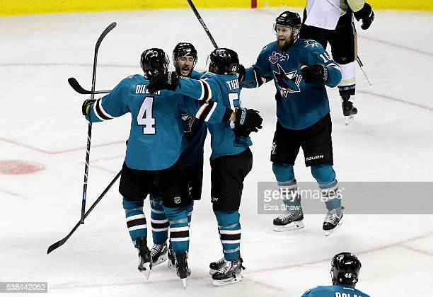 Melker Karlsson of the San Jose Sharks celebrates with Brenden Dillon and Chris Tierney after scoring against the Pittsburgh Penguins in the third...