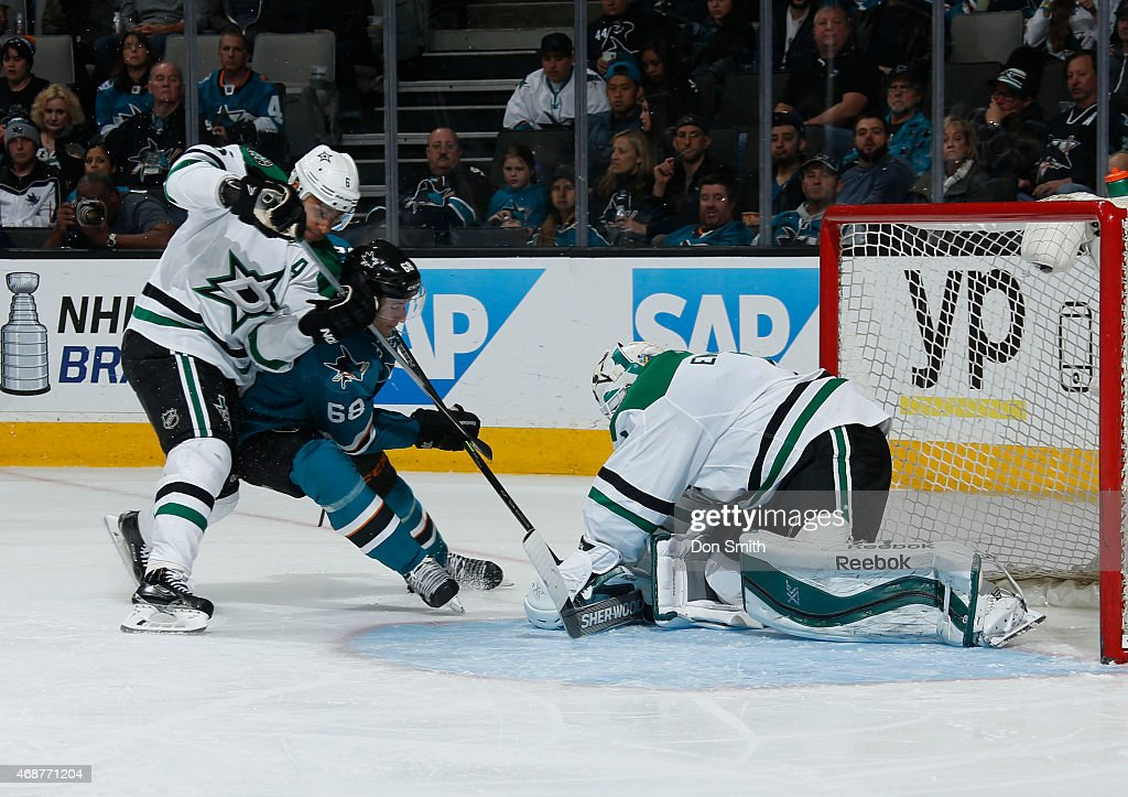 Melker Karlsson #68 of the San Jose Sharks crashes the net for a shot against Trevor Daley #6 and Jhonas Enroth #1 of the Dallas Stars at the SAP Center on April 6, 2015 in San Jose, California .