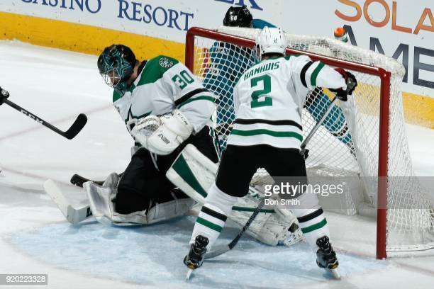 Melker Karlsson of the San Jose Sharks gets the puck by Ben Bishop of the Dallas Stars to score a goal in the first period at SAP Center on February...