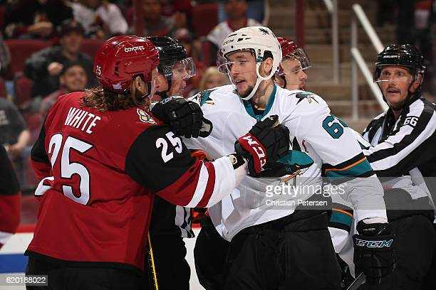 Melker Karlsson of the San Jose Sharks has words with Ryan White of the Arizona Coyotes during the third period of the NHL game at Gila River Arena...