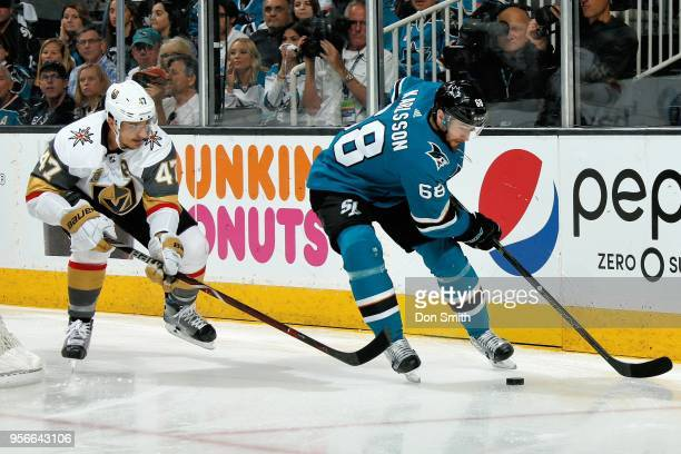 Melker Karlsson of the San Jose Sharks keeps the puck ahead of Luca Sbisa of the Vegas Golden Knights in Game Six of the Western Conference Second...