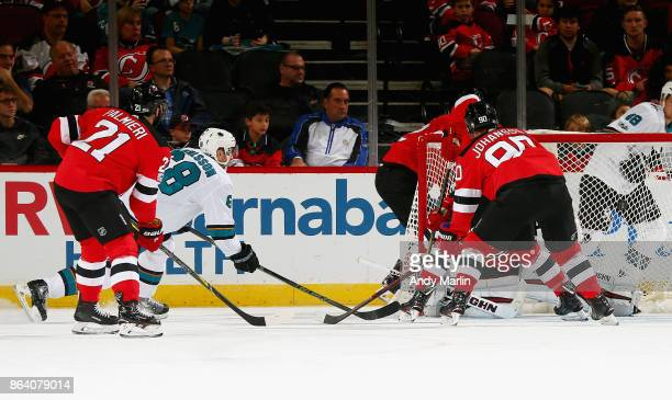 Melker Karlsson of the San Jose Sharks puts the puck past Scott Wedgewood of the New Jersey Devils for a firstperiod goal during the game at...