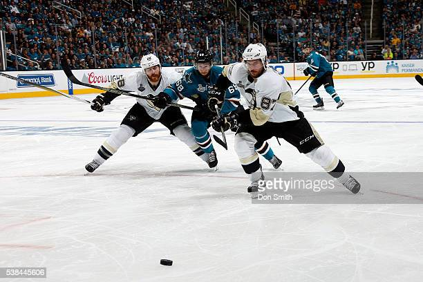 Melker Karlsson of the San Jose Sharks races towards the puck against Sidney Crosby and Ian Cole of the Pittsburgh Penguins in Game Four of the 2016...