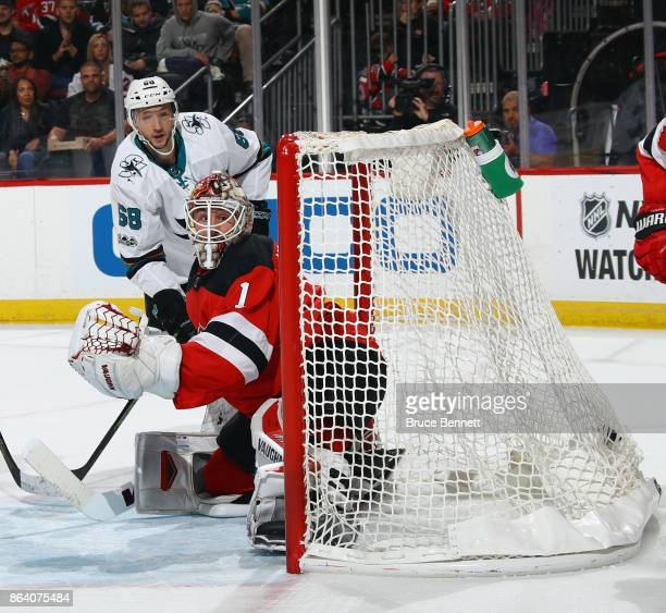 Melker Karlsson of the San Jose Sharks scores at 1411 of the first period against Keith Kinkaid of the New Jersey Devils at the Prudential Center on...