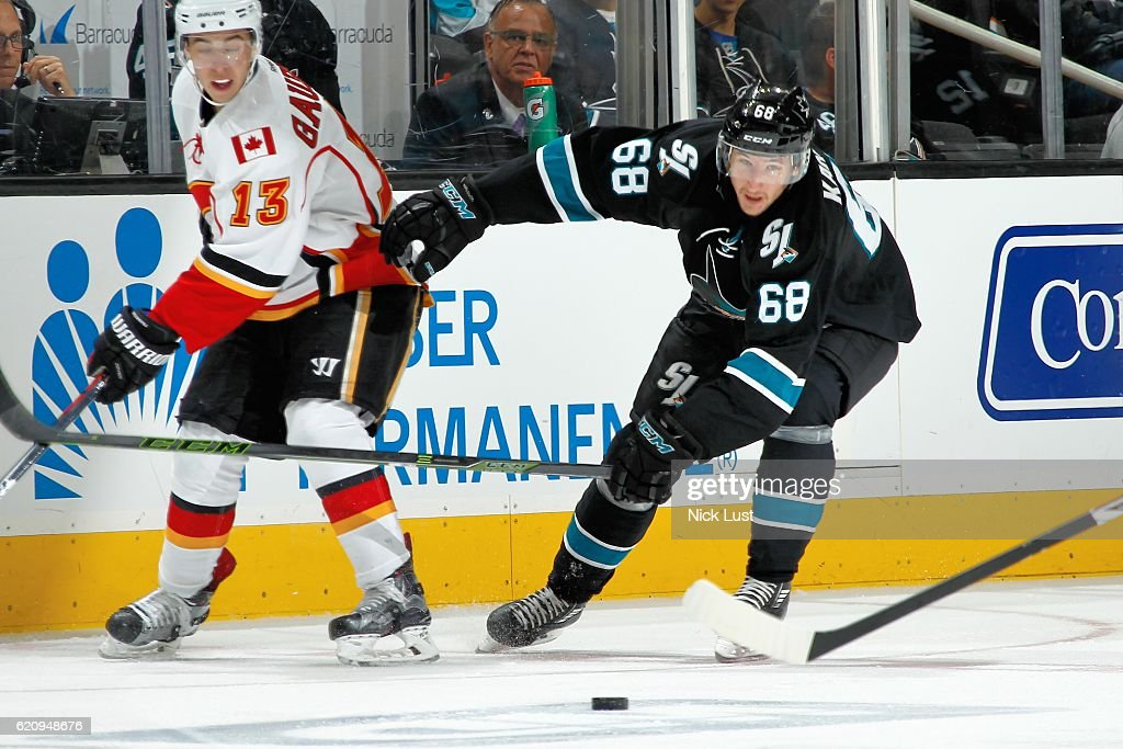 Melker Karlsson #68 of the San Jose Sharks skates against Johnny Gaudreau #13 of the Calgary Flames during a NHL game at SAP Center at San Jose on November 3, 2016 in San Jose, California.