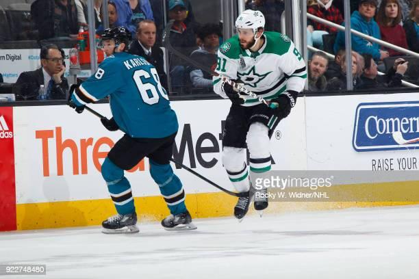Melker Karlsson of the San Jose Sharks skates against Tyler Seguin of the Dallas Stars at SAP Center on February 18 2018 in San Jose California