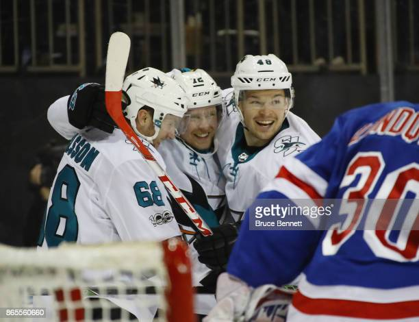 Melker Karlsson Tim Heed and Tomas Hertl of the San Jose Sharks celebrate Heed's first NHL goal against the New York Rangers at 1245 of the first...