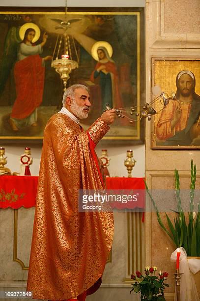 Melkite priest Emile Shoufani celebrating mass in Nazareth