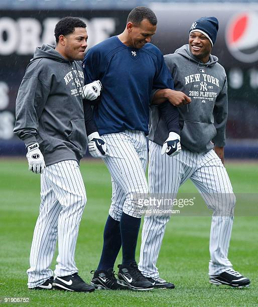 Melky Cabrera Alex Rodriguez and Robinson Cano of the New York Yankees warm up in the outfield during workouts on October 15 2009 at Yankee Stadium...