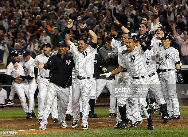 Melky Cabrera Alex Rodriguez and the New York Yankees celebrate the walk off home run in the eleventh inning against the Minnesota Twins in Game Two...