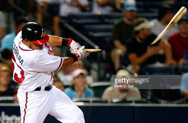 Melky Cabrera of the Atlanta Braves breaks his bat on a single in the eighth inning against the Milwaukee Brewers at Turner Field on July 15 2010 in...