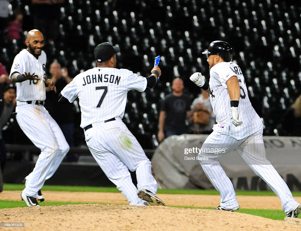 Melky Cabrera (R) of the Chicago White Sox celebrates with Micah Johnson #7 and Alexei Ramirez (L) his game winning single during the fourteenth inning on September 15, 2015 at U.S. Cellular Field in Chicago, Illinois. The White Sox won 8-7 in fourteen innings.