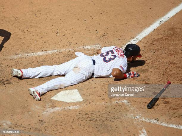 Melky Cabrera of the Chicago White Sox hits the ground after a close pitch in the 6th inning against the Texas Rangers at Guaranteed Rate Field on...