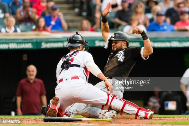 Melky Cabrera of the Chicago White Sox is tagged out at home by catcher Yan Gomes of the Cleveland Indians to end the top of the second inning at...