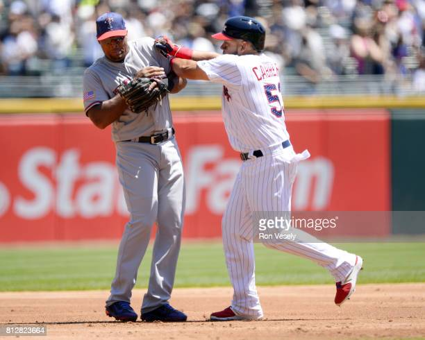 Melky Cabrera of the Chicago White Sox playfully runs into third baseman Adrian Beltre of the Texas Rangers after Cabrera hit a home run on July 2...