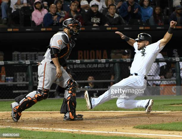 Melky Cabrera of the Chicago White Sox slides safely into home plate as Welington Castillo of the Baltimore Orioles waits for the throw during the...