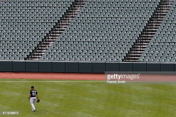 Melky Cabrera of the Chicago White Sox walks the outfield in the first inning against the Baltimore Orioles at an empty Oriole Park at Camden Yards...