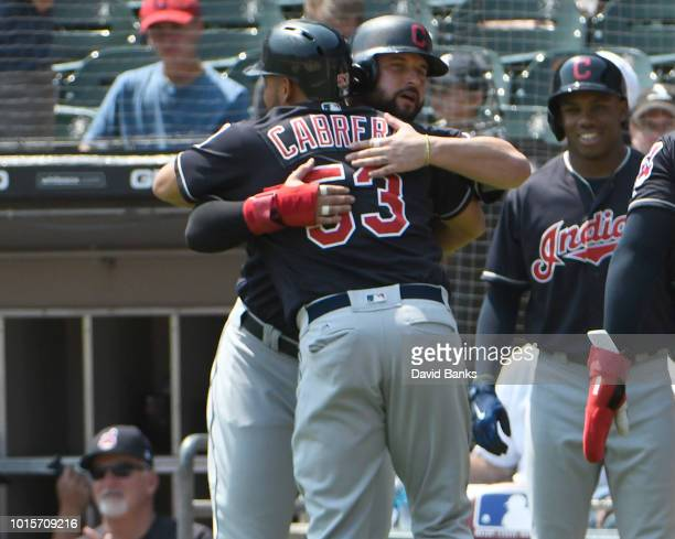 Melky Cabrera of the Cleveland Indians is greeted by Yonder Alonso after hitting a threerun home run against the Chicago White Sox during the first...