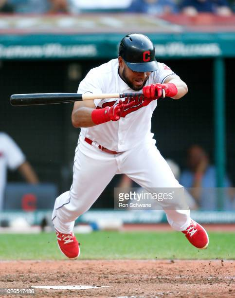 Melky Cabrera of the Cleveland Indians jumps out of the way of a pitch from Brian Flynn of the Kansas City Royals during the eighth inning at...