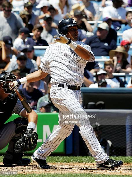 Melky Cabrera of the New York Yankees doubles in the 3rd inning against the Chicago White Sox on July 16, 2006 at Yankee Stadium in the Bronx borough...