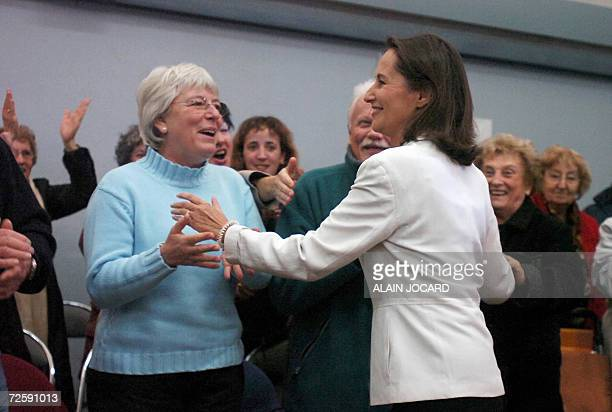 French Socialist Party candidate in 2007 presidential elections Segolene Royal shakes hand with her supporters 17 November 2006 in Melle center...