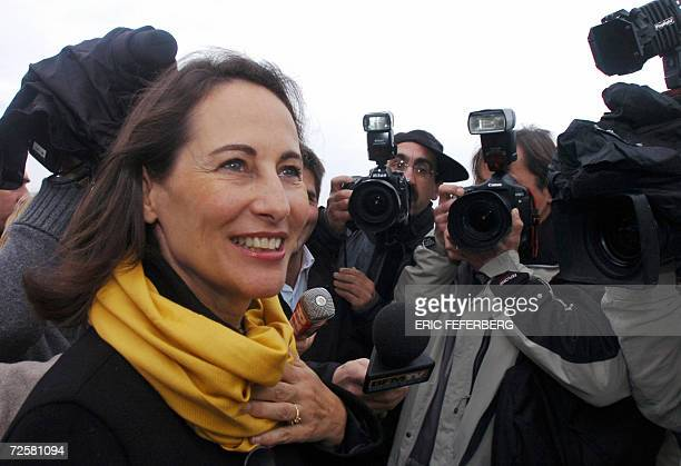 Segolene Royal one of the three candidates for the Socialist nomination in the 2007 French presidential race poses for photographers are she arrives...