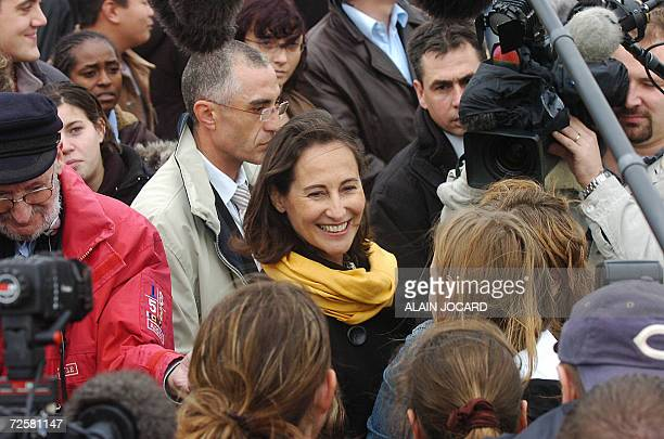 Segolene Royal one of the three candidates for the Socialist nomination in the 2007 French presidential race speaks with students during the ceremony...