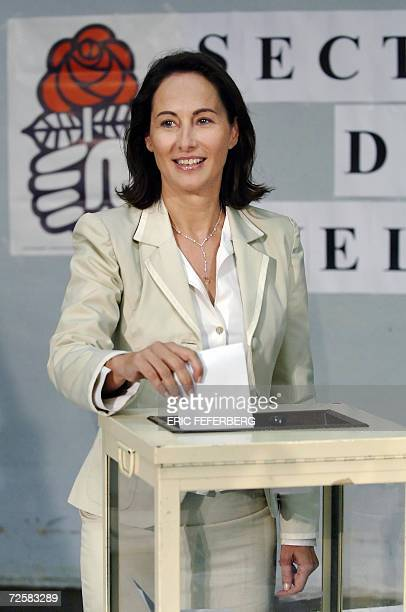 Segolene Royal one of the three candidates for the Socialist nomination in the French 2007 presidential race casts her ballot 16 November 2006 in...
