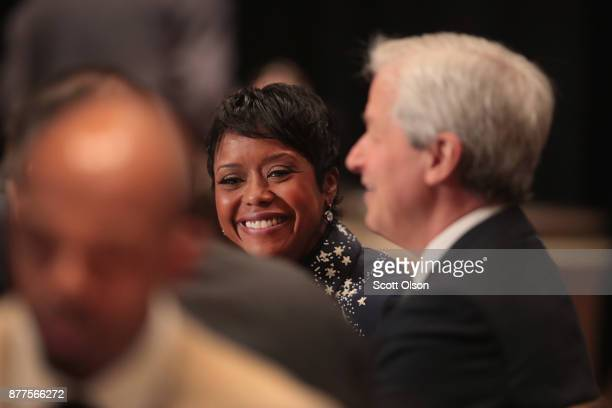 Mellody Hobson president of Ariel Investments chats with Jamie Dimon chairman and CEO of JPMorgan Chase Co during a luncheon hosted by The Economic...
