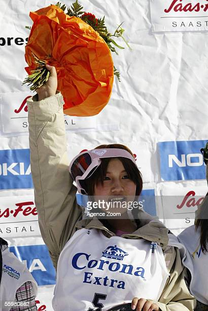 Melo Imai of Japan celebrates victory on the podium during the Ladies FIS World Cup Snowboard Halfpipe event on October 21 2005 in Saas Fee...
